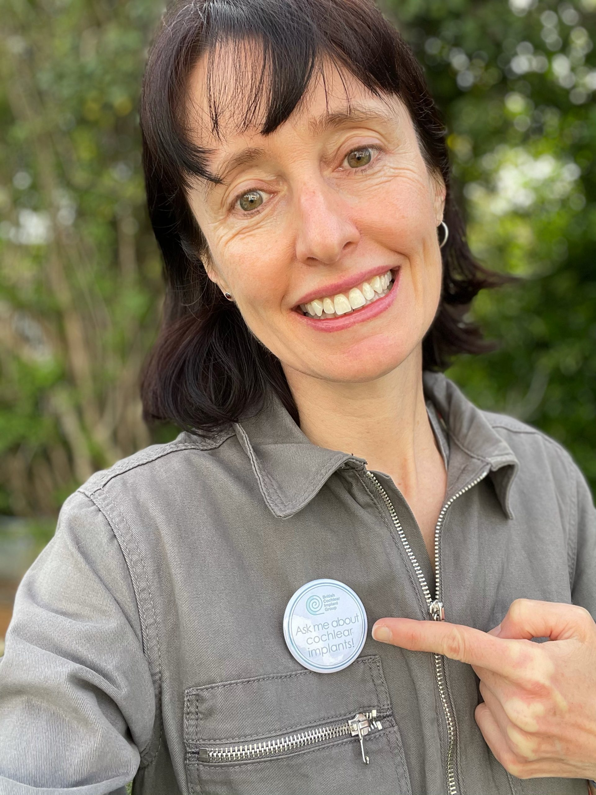 Helen Cullington, Chair of BCIG, UK,  wears her badge – ask me about cochlear implants!
